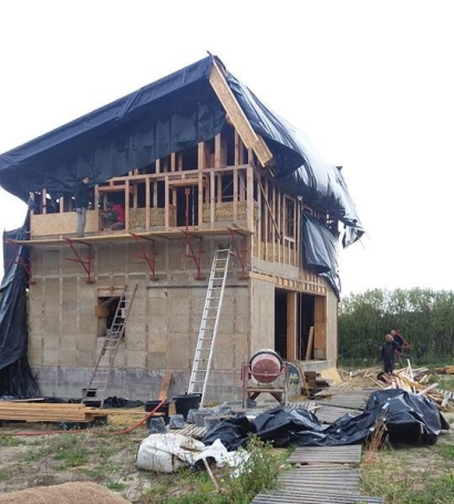 Construire une maison en bois paille